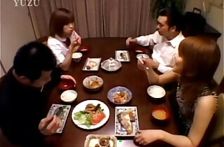 A Asian teenager is sitting at the dining table. Wit from xxx tube video