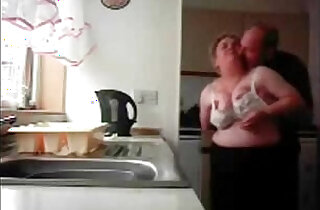 Mum and dad home alones having fun in the kitchen. Hidden cam xxx tube video